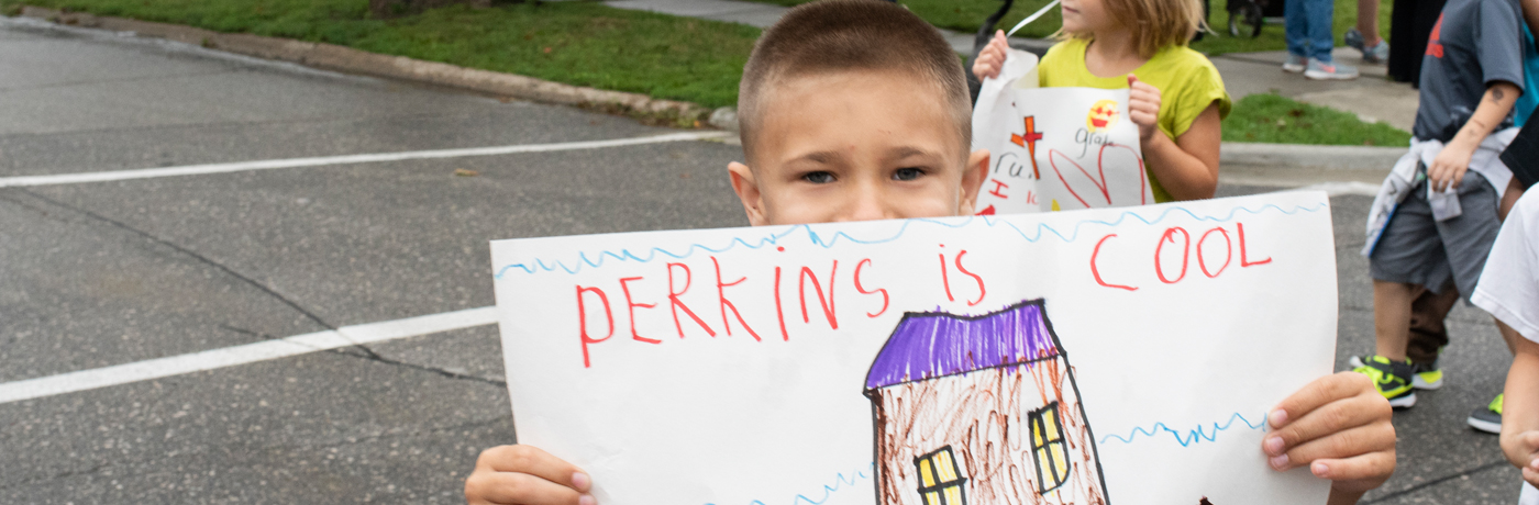 Perkins Elementary School Student Holding Sign